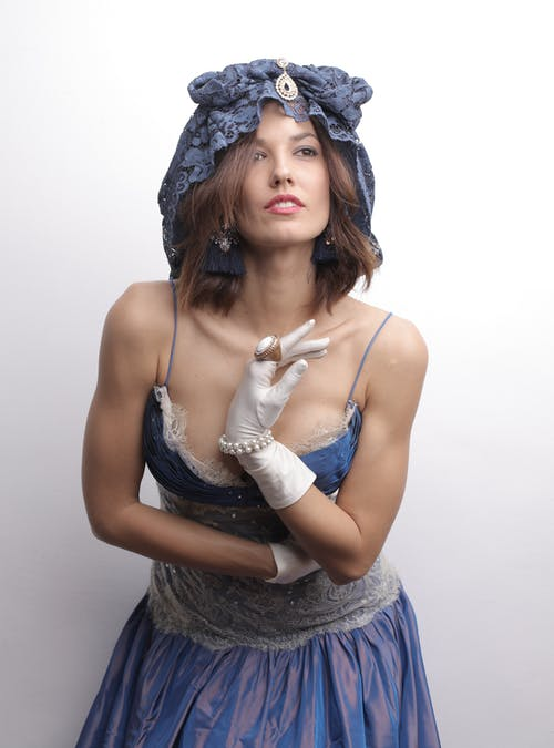 Alluring woman wearing boho clothes and accessories in studio