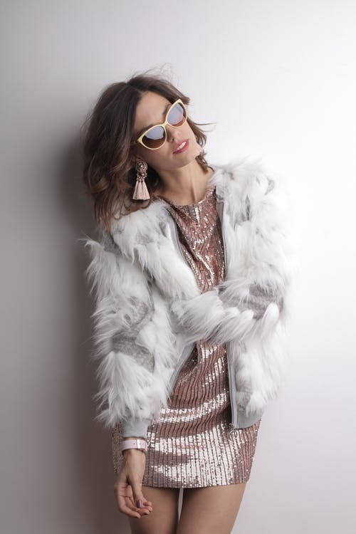 Woman in White Fur Coat Wearing Brown Sunglasses