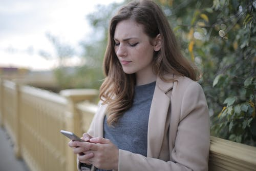 Pensive Woman in Using Smartphone