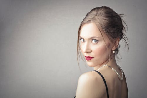Attractive Woman Wearing Pearl Accessories