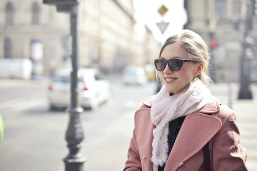 Woman in Pink Coat Wearing Black Sunglasses
