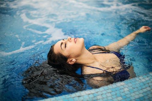 Woman In Blue Bikini On Swimming Pool