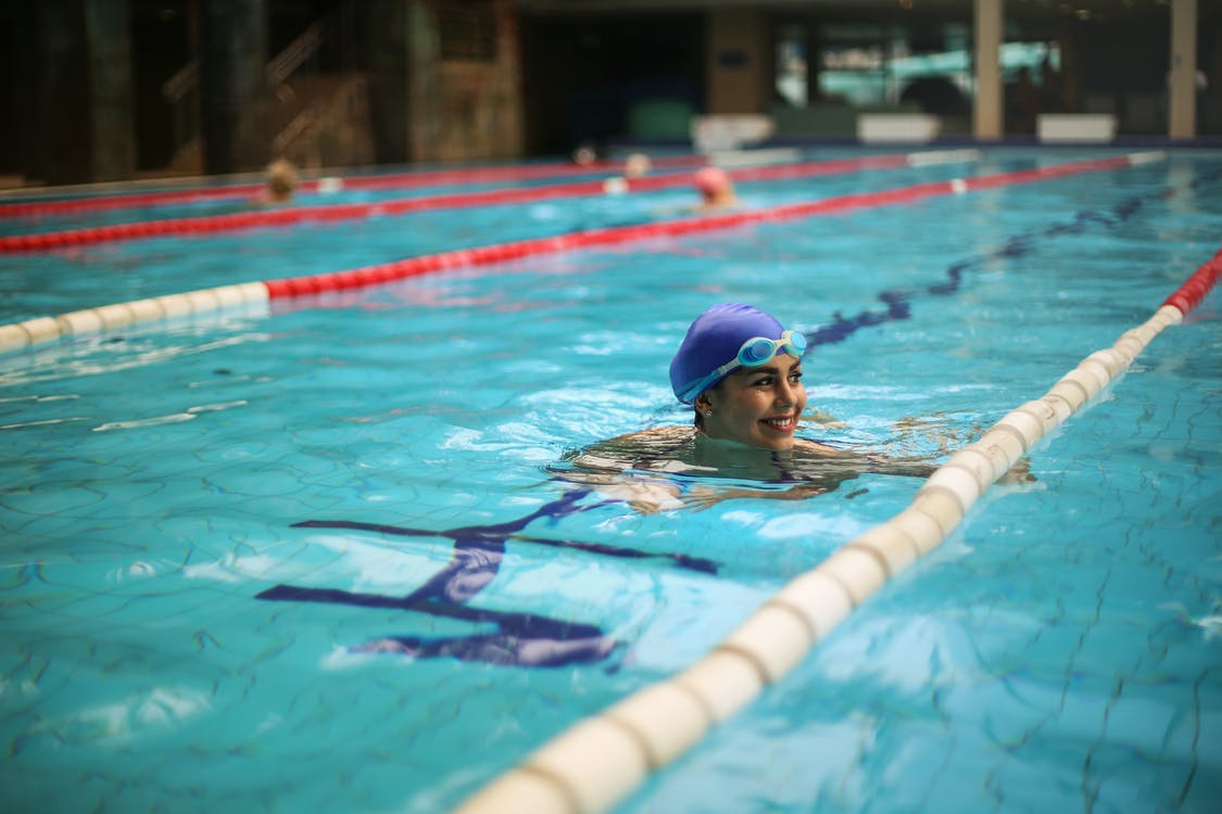 A Woman In the Middle of The Swimming Pool
