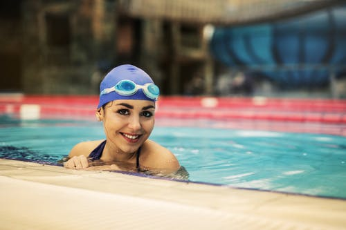 Woman in Blue Swimming Goggles in Swimming Pool