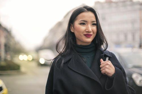 Woman in Black Coat Standing on Street