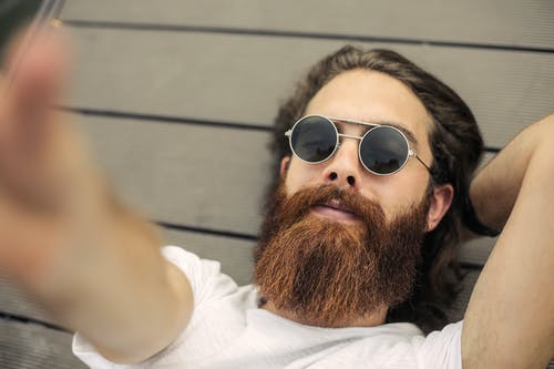 Bearded Man Wearing White Shirt and Black Sunglasses