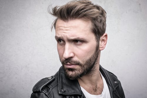 Bearded Man in Black Leather Jacket