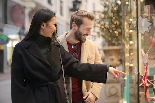 Man in Brown Coat Standing Beside Woman in Black Coat
