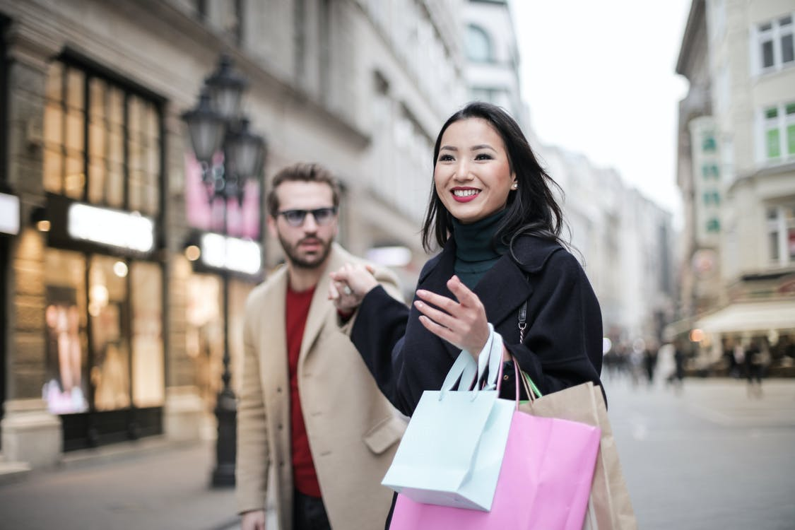 Woman in Black Coat Holding a Shopping Bags