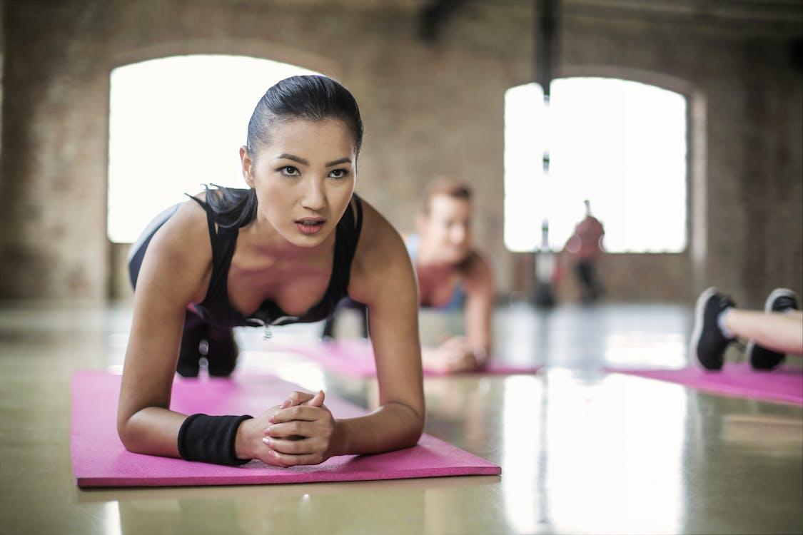 Women Doing a Yoga on Yoga Mat