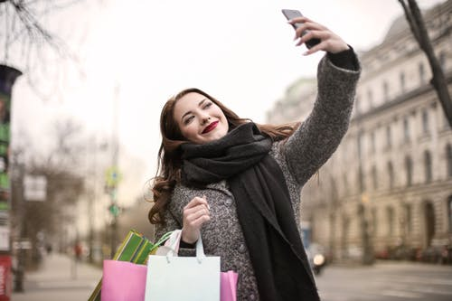 Woman Taking a Selfie Using Smartphone