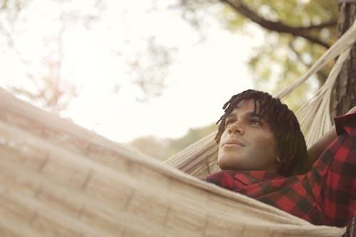 Man Lying on Hammock
