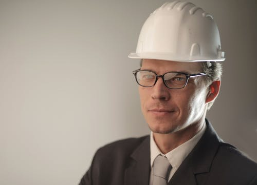 Man in Black Suit Jacket Wearing Hard Hat