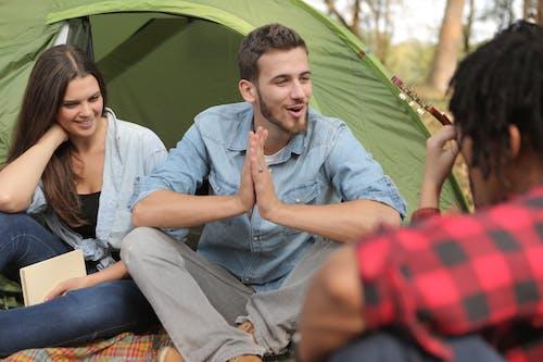 Cheerful friends having fun in camp