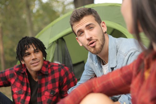 Friends spending time together at campsite