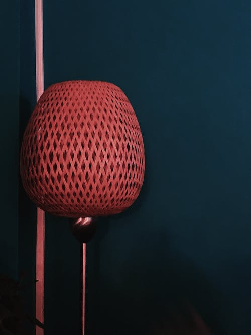 Stylish decorative lamp near blue wall