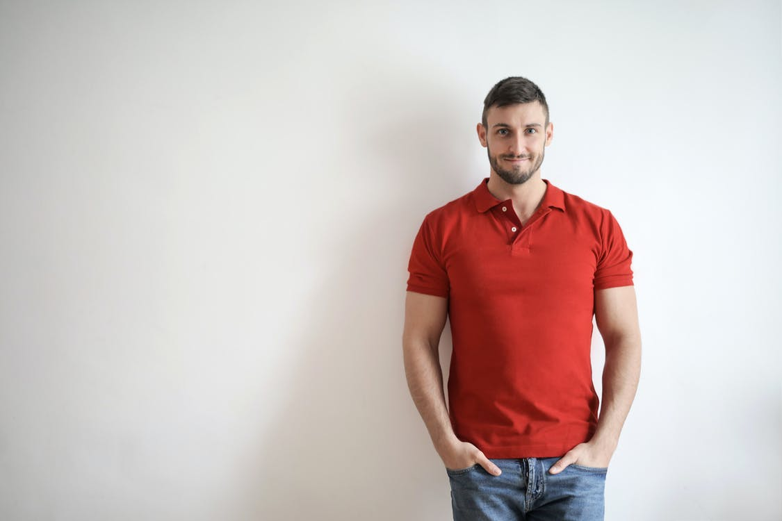 Man in Red Polo Shirt and Blue Denim Jeans