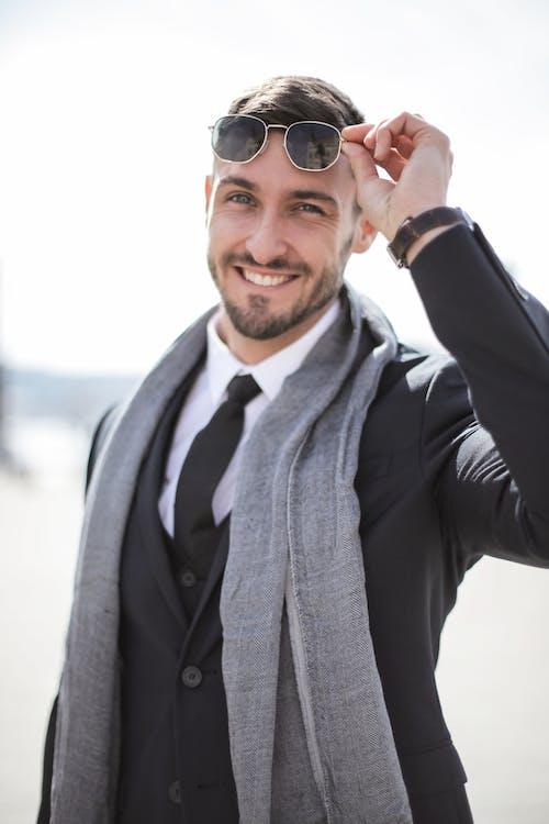 Man in Black Jacket Wearing Black Sunglasses Smiling