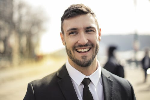 Man in Black Suit Smiling