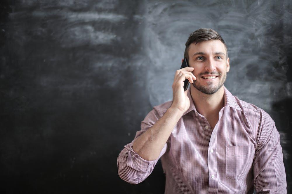 Man using mobile phone.   Photo: Pexels