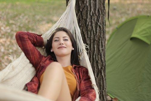 Shallow Focus Photo of Woman Lying on Hammock
