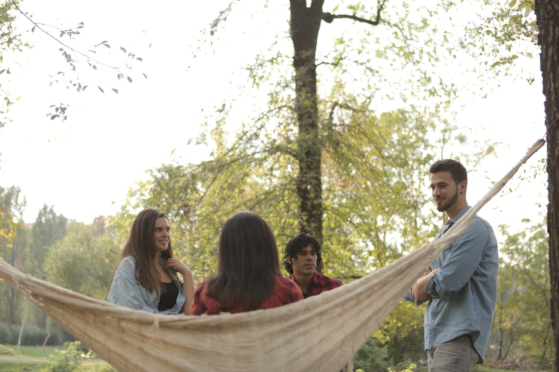 Cheerful friends gathering in park