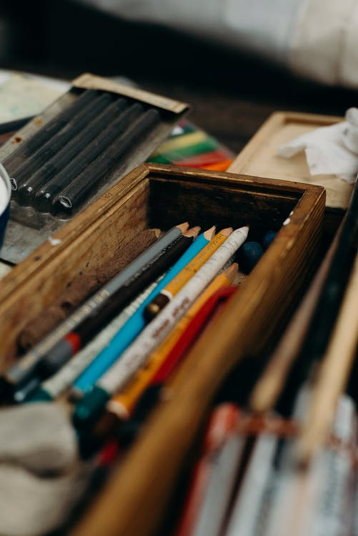 Photo of Pencils on Brown Wooden Box