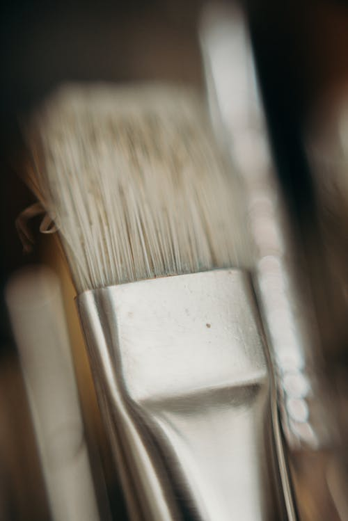 Close-Up Photo of White and Brown Paint Brush