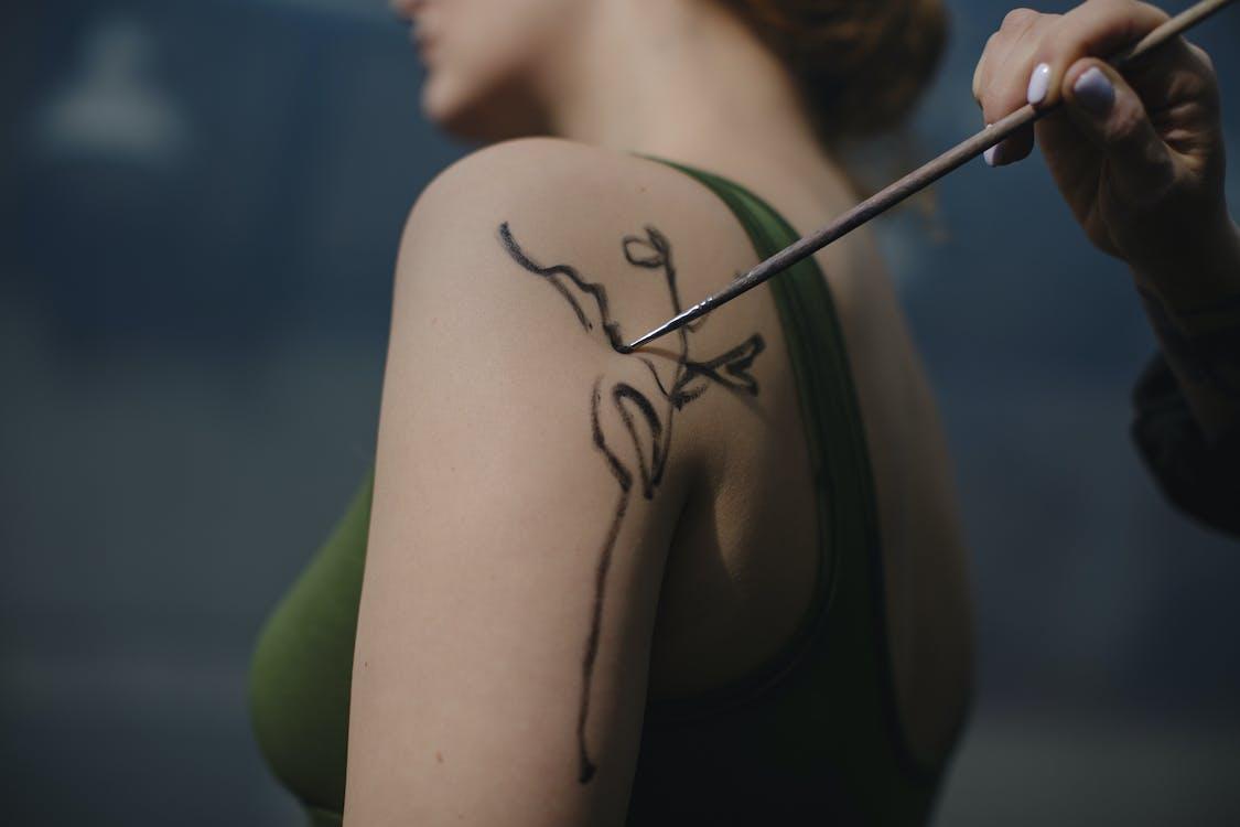 Woman Having a Henna Tattoo