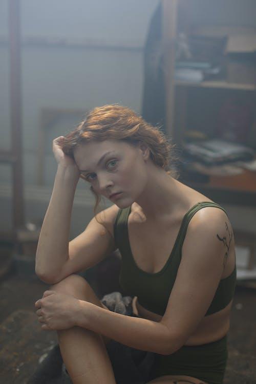 Woman in Green Sport Bra Sitting on Floor