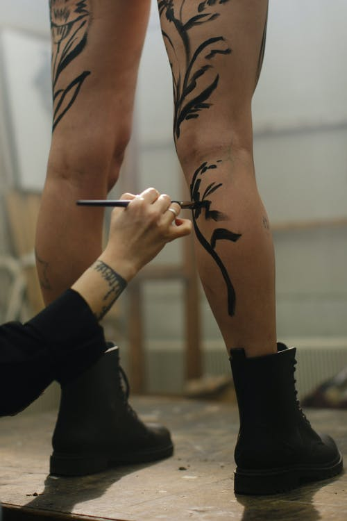 Artist Painting on Person Legs