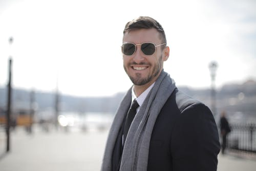 Man In Black Suit Wearing Sunglasses