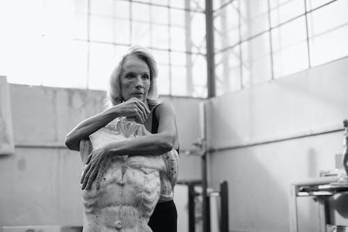 Grayscale Photo of Elderly Woman in Black Tank Top