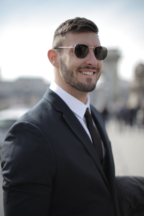 Man in Black Suit Wearing Black Sunglasses