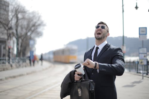 Man in Black Suit Jacket While Shouting