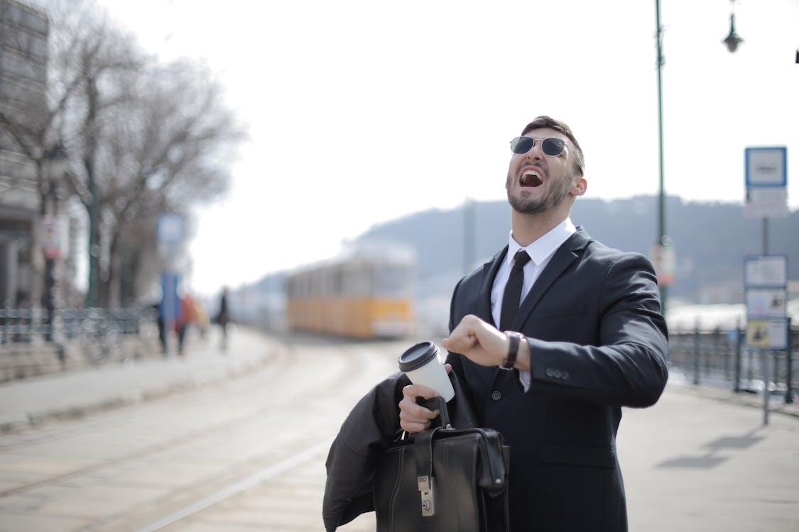 Man in Black Suit Jacket While Shouting