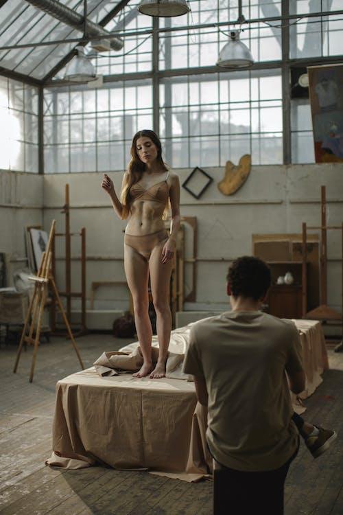 Woman In Under Garment Standing In The Platform