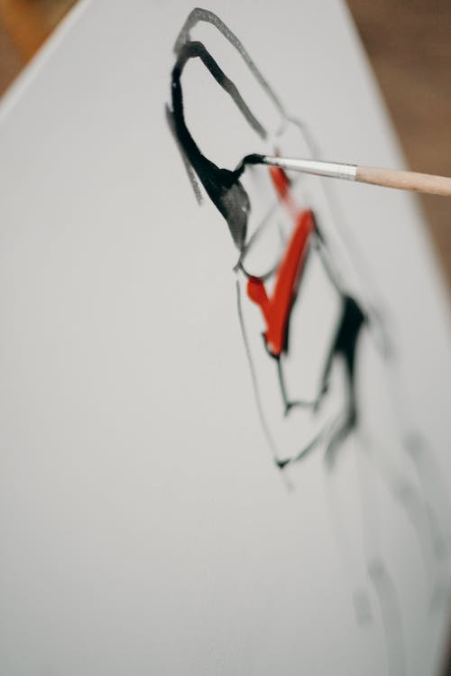 Person Painting on Paper
