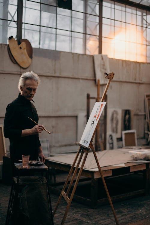 Elderly Man in Black Long Sleeves Holding a Paint Brush
