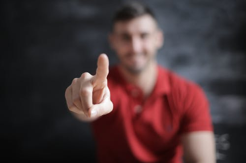 Selective Focus Photo of Man's Index Finger