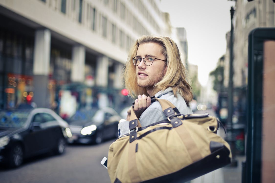 Man Holding His Duffel Bag