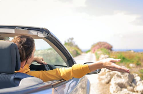 Woman in Yellow Long Sleeve Driving Car
