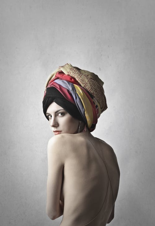 Topless Woman Wearing Headscarf