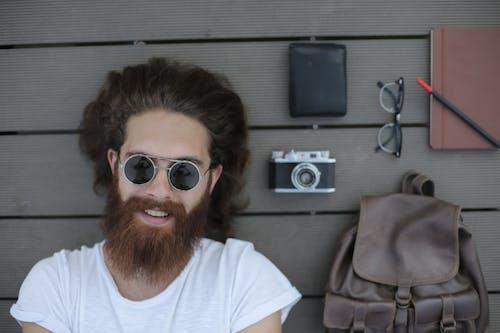 Man in White Shirt Wearing Silver Framed Sunglasses