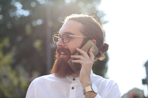 Man Using Mobile Phone During Daylight