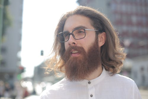 Man in White Button Up Shirt Wearing Black Framed Eyeglasses