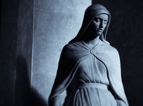 Grayscale Photo of a Woman Statue