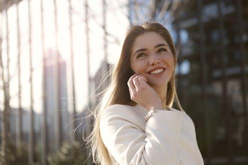 Smiling Woman In White Blazer