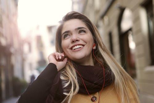 A Joyful Woman Standing Near Building