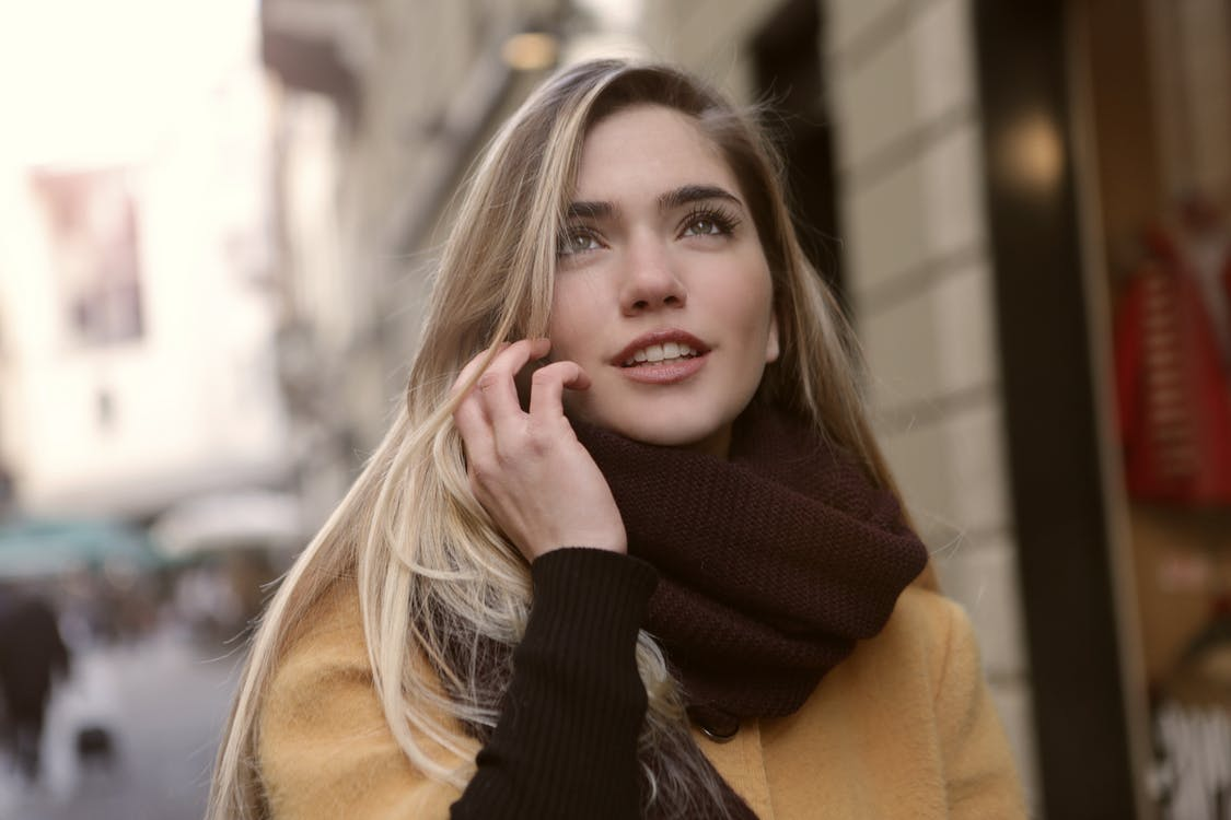 Woman in Brown Coat and Brown Scarf